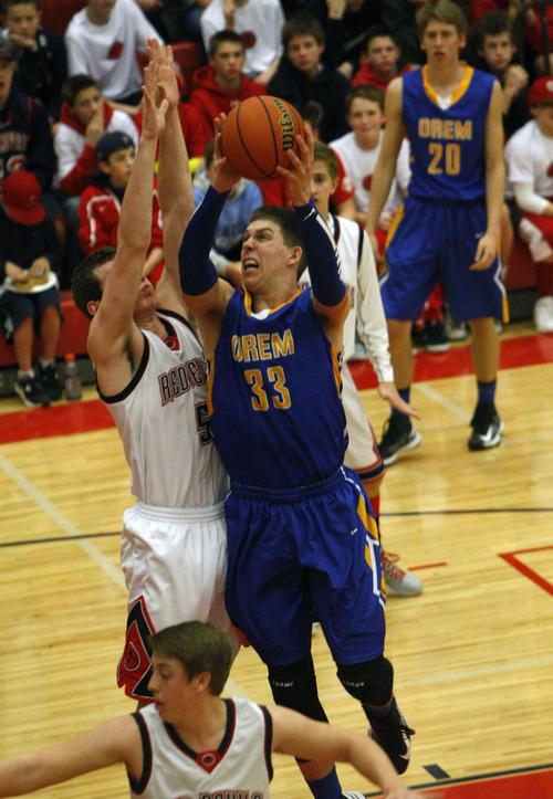 Chris Detrick     The Salt Lake Tribune Orem's Dalton Nixon (33) shoots past Springville's Max Schreiner (5) during the game at Springville High School Friday January 11, 2013.