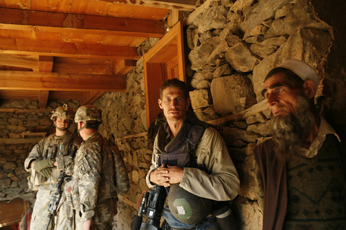 """War photographer Tim Hetherington (center) in a self-portrait. He is the subject of """"Which Way Is the Front Line From Here? The Life and Time of Tim Hetherington,"""" one of the titles in the Documentary Premieres section of the 2013 Sundance Film Festival. Tim Hetherington    Courtesy Sundance Institute"""