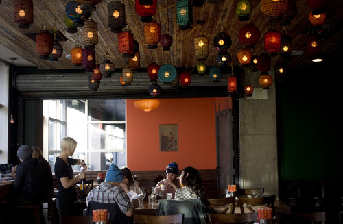 Kim Raff     Tribune file photo A waitress is opening a bottle at Plum Alley in Salt Lake City. Utah law enforcement officials announced Tuesday that they will not be citing restaurants if they serve diners a drink before ordering food, so long as customers eventually do order.