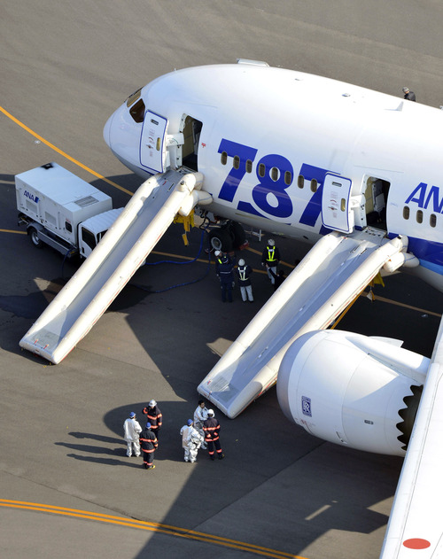 "An All Nippon Airways flight sits at Takamatsu airport in Takamatsu, western Japan after it made an emergency landing Wednesday, Jan. 16, 2013. The flight to Tokyo from Ube in western Japan landed at the airport after a cockpit message showed battery problems, in the latest trouble for the Boeing 787 ""Dreamliner."" (AP Photo/Yomiuri Shimbun, Yasufumi Nagao) JAPAN OUT, MANDATORY CREDIT"