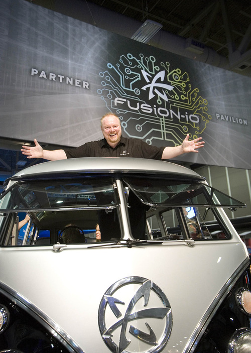 Paul Fraughton  |   The Salt Lake Tribune Rick White of Fusion-io  stands in the company's 1962 VW minibus Safari Edition with the company logo  on the front panel. The van was part of Fusion-io's elaborate booth at SC12, a  supercomputing convention at the Salt Palace Convention Center on Tuesday, Nov. 13, 2012.