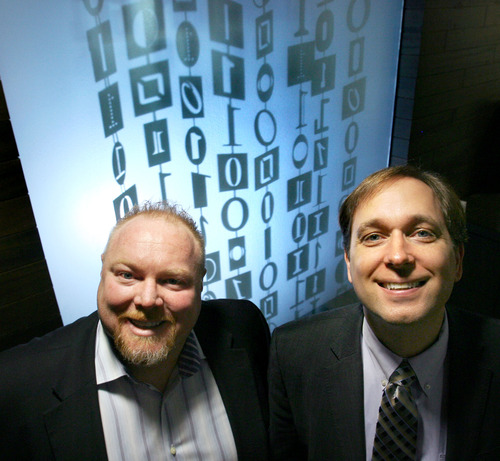 Steve Griffin  |  The Salt Lake Tribune  Fusion-io is a surging technology company, a leader in providing solid-state (chip-based) memory for servers in huge data centers. Here, co-founders  Rick White and David Flynn are photographed in front of the binary code that spells out Fushion-io in the company's Cottonwood Heights headquarters. T