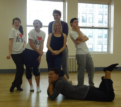 """Courtesy Rick Kimball Kyle Dunshee, back, Abby Watts, left, Gabee Snarr, Alicia Albright, Dallin Dorius, and McKylin Rowe, on floor, learned how rigorous the coreography process can be for a major production from Alicia Albright, one of the dance captains for the Broadway show, """"Wicked."""""""