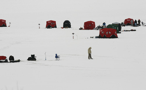"Scott Sommerdorf   |  The Salt Lake Tribune A small section of the total number of ice fishers on Scofield Reservoir, Saturday, December 29, 2012. Utah State Parks is holding a ""Trifishalon"" ice fishing tournament. The first leg of the tournament was Saturday at Scofield Reservoir."