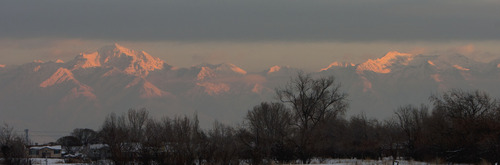 Steve Griffin | The Salt Lake Tribune    The peaks of the Wasatch Range rise above the Salt Lake Valley smog as they catch the last sun rays of the day Tuesday January 15, 2013.
