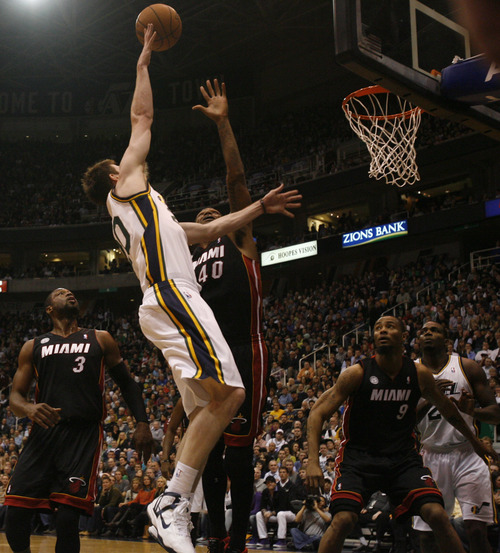 Rick Egan  | The Salt Lake Tribune   Utah Jazz shooting guard Gordon Hayward (20) takes a shot overMiami Heat power forward Udonis Haslem (40), in NBA action, Utah Jazz vs.The Miami Heat, Monday, January 14, 2013. The foul was ruled intentional.
