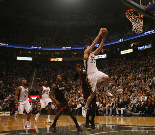 Rick Egan  | The Salt Lake Tribune   Utah Jazz shooting guard Gordon Hayward (20) goes in for a lay-up in NBA action, Utah Jazz vs.The Miami Heat, Monday, January 14, 2013. The foul was ruled intentional.
