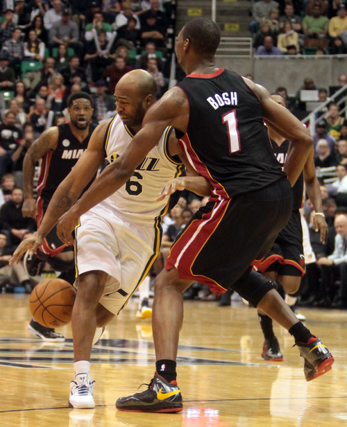 Rick Egan  | The Salt Lake Tribune   Miami Heat center Chris Bosh (1) knocks the ball away from Utah Jazz point guard Jamaal Tinsley (6), in NBA action, Utah Jazz vs.The Miami Heat, Monday, January 14, 2013. The foul was ruled intentional.