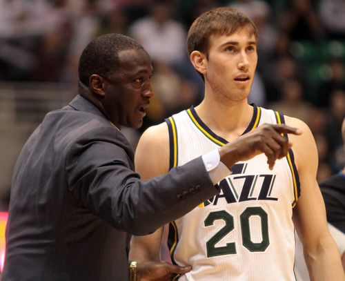 Rick Egan  | The Salt Lake Tribune   Utah Jazz head coach Tyrone Corbin has a chat with Utah Jazz shooting guard Gordon Hayward (20) during a break in the action, in NBA action, Utah Jazz vs.The Miami Heat, Monday, January 14, 2013. The foul was ruled intentional.