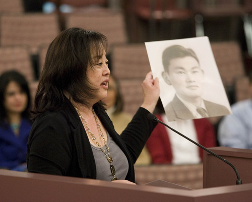 Paul Fraughton  |  The Salt Lake Tribune Former Salt Lake County councilwoman Jani Iwamoto holds a photo of Fred Korematsu as she talks Tuesday to the County Council about Korematsu's conviction for not reporting  for internment during World War II and his subsequent legal battles to have his conviction overturned.