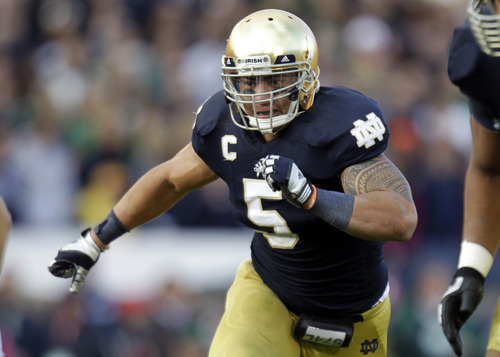FILE - In this Oct. 20, 2012, file photo, Notre Dame linebacker Manti Te'o chases the action during the second half of an NCAA college football game against the BYU in South Bend, Ind. (AP Photo/Michael Conroy, File)