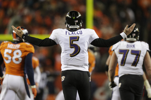 Baltimore Ravens quarterback Joe Flacco (5) reacts against the Denver Broncos in overtime of an AFC divisional playoff NFL football game, Saturday, Jan. 12, 2013, in Denver. (AP Photo/Joe Mahoney)