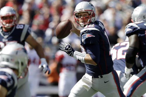 New England Patriots quarterback Tom Brady (12) looks for a receiver against the Arizona Cardinals in the first half of an NFL football game, Sunday, Sept. 16, 2012, in Foxborough, Mass. (AP Photo/Elise Amendola)
