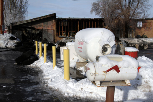 Francisco Kjolseth     The Salt Lake Tribune Uintah County firefighters fought and contained a fire to a storage building at Basin Propane Systems in Vernal on Tuesday, January 15, 2013, managing to keep the flames away from the large propane tanks nearby.