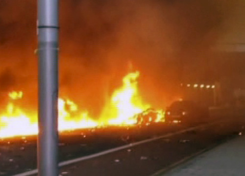 In this image taken from amateur video, showing a line of flaming debris shortly after a helicopter crash in central London, early Wednesday Jan. 16, 2013.  Police say two people were killed when a helicopter crashed during rush hour in central London after apparently hitting a construction crane on the side of St. George's Tower in the Vauxhall area of central London. (AP Photo / Nic Walker)