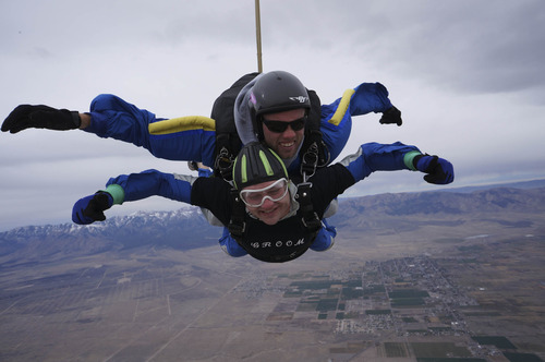 Courtesy Allan Wood Allan Wood skydives with help of Skydive Utah instructor moments after being married.
