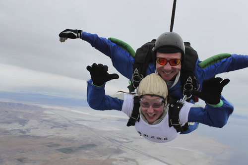 Courtesy Allan Wood Emily Wood makes the third jump of her life with help from a Skydive Utah instructor moments after being married.