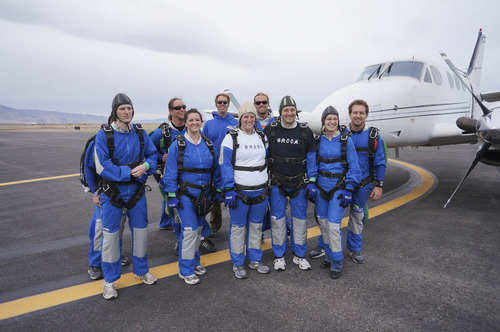 Prior to jump, Emily and Allan Wood joined their wedding party and instructors at the Tooele County Airport.  Courtesy Allan Wood