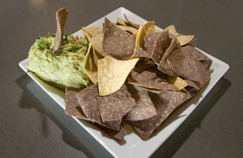Paul Fraughton  |  The Salt Lake Tribune An order of  traditional guacamole with chips from Taqueria 27.