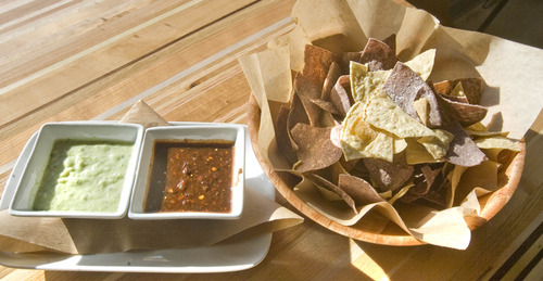 Paul Fraughton  |  The Salt Lake Tribune An order of  fresh fried tortilla chips with salsas at Taqueria 27.