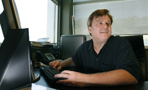 Salt Lake City-  Patrick Byrne, chief executive of Utah's Overstock.com, works in his office in Cottonwood Heights Thursday July 31, 2008.  Steve Griffin/The Salt Lake Tribune 7/31/08