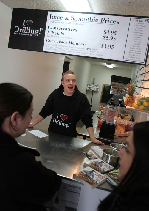 Francisco Kjolseth  |  The Salt Lake Tribune Isaac Burnett, talks about some of the juices and smoothies available to customers at the I Love Drilling Juice & Smoothie Bar where liberals pay extra, drumming up support and controversty with his father's latest venture.