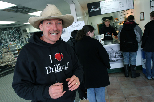 """Francisco Kjolseth     The Salt Lake Tribune George Burnett, owner of Covers & Camo in Vernal Utah where he sells custom seat covers along with apparel and stickers with the slogan """"I (Heart) Drilling!"""", talks about his latest venture and controversy. Added to his shop is the I Love Drilling Juice & Smoothie Bar where liberals pay extra. As Burnett puts it """"liberal policies are costing us more,"""" and so if you admit to being liberal you can expect to pay more for your drink."""