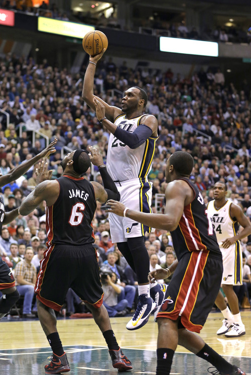 Utah Jazz center Al Jefferson (25) shoots as Miami Heat forward LeBron James (6) and guard Mario Chalmers, right, look on in the fourth quarter during an NBA basketball game Monday, Jan. 14, 2013, in Salt Lake City. The Jazz defeated the Heat 104-97. (AP Photo/Rick Bowmer)