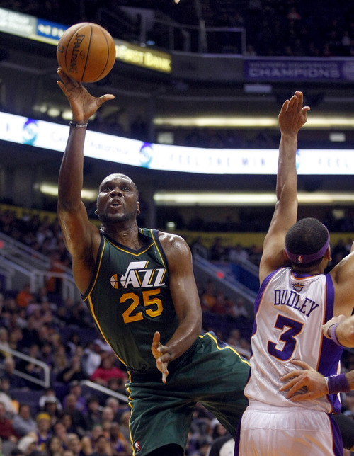 Utah Jazz center Al Jefferson (25) shoots off balance on Phoenix Suns shooting guard Jared Dudley (3) in the first quarter during an NBA basketball game on Friday, Dec. 14, 2012, in Phoenix. (Rick Scuteri/AP Photos)