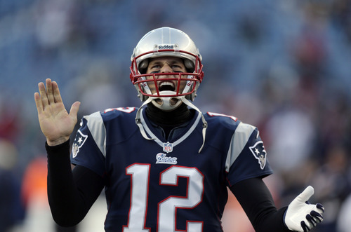 New England Patriots quarterback Tom Brady shouts as he takes the field before an NFL football game against the Miami Dolphins in Foxborough, Mass., Sunday, Dec. 30, 2012. (AP Photo/Charles Krupa)