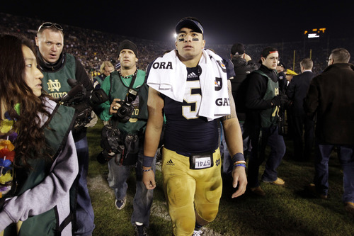 FILE - In this Nov. 17, 2012, file photo, Notre Dame linebacker Manti Te'o walks off the field following an NCAA college football game against Wake Forest in South Bend, Ind. A story that Te'o's girlfriend had died of leukemia, a loss he said inspired him to help lead the Irish to the BCS championship game, was dismissed by the university Wednesday, Jan. 16, 2013, as a hoax perpetrated against the linebacker. (AP Photo/Michael Conroy, File)