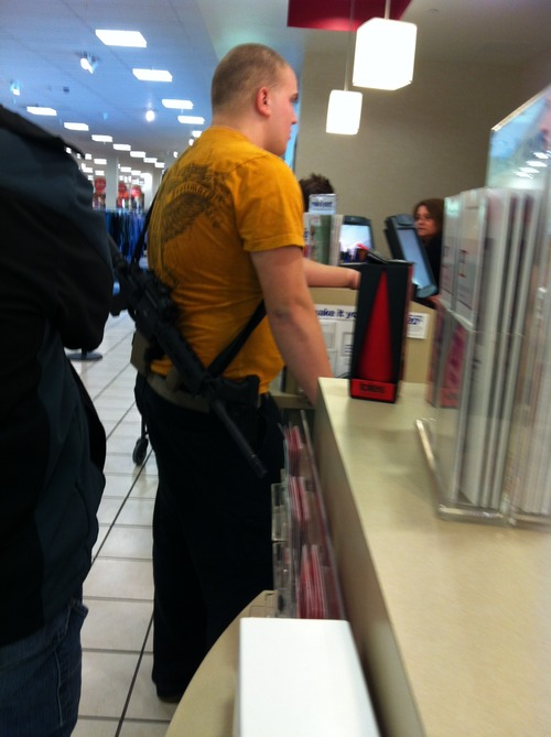 Courtesy of Cindy Yorgason During a visit to JCPenney in Riverdale on Wednesday, Cindy Yorgason saw a man with a large rifle and handgun. Yorgason quickly took two pictures of the man with her cellphone. She said the photos have since gone viral on Facebook.