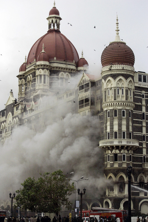 FILE - In this Nov. 29, 2008 file photo, smoke billows from the Taj Mahal Hotel in Mumbai, India, during a 60-hour rampage through India's financial capital that killed more than 160 people. On Thursday, Jan. 17, 2013, Chicago businessman Tahawwur Rana, 52, is scheduled to be sentenced at federal court in Chicago for providing support to a Pakistani group that carried out the 2008 Mumbai attack, as well as for his backing of an unrealized plot to attack a Danish newspaper that printed cartoons of the Prophet Muhammad. He was convicted in 2011.  (AP Photo/Altaf Qadri, File)