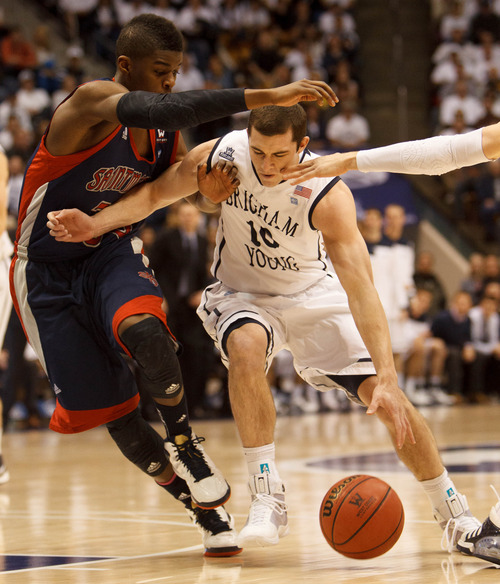 Trent Nelson  |  The Salt Lake Tribune BYU guard Matt Carlino (10) drives on Saint Mary's guard James Walker III (35) as BYU hosts Saint Mary's, college basketball Wednesday January 16, 2013 in Provo.