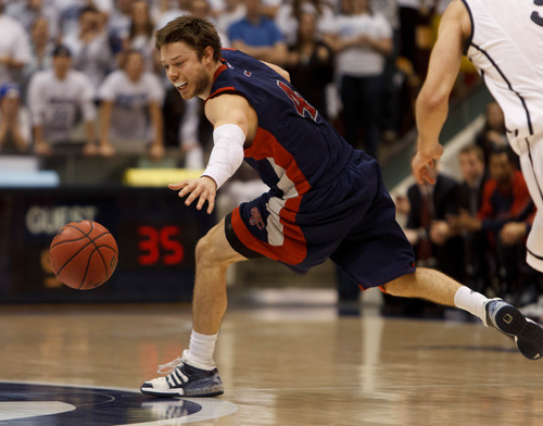 Trent Nelson  |  The Salt Lake Tribune Saint Mary's guard Matthew Dellavedova (4) reaches for a loose ball as BYU hosts Saint Mary's, college basketball Wednesday January 16, 2013 in Provo.