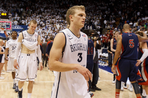 Trent Nelson  |  The Salt Lake Tribune BYU guard Tyler Haws (3) and BYU forward Nate Austin (33) walk off the court after Saint Mary's guard Matthew Dellavedova (4) hit a last-second shot to win the game. BYU hosts Saint Mary's, college basketball Wednesday January 16, 2013 in Provo.