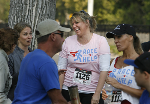 "Scott Sommerdorf  |  The Salt Lake Tribune              Meri Brown, center, from the TV program ""Sister Wives,"" talks with other runners on Sept. 22, 2012, near the starting line of the 5K run to benefit Holding Out Help, a group that helps people leaving polygamy. Brown's family is suing the state of Utah in federal court, claiming the state's bigamy law is unconstitutional."