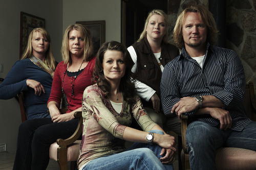 "Kody Brown, right, with ""sister wives"" Christine, left, Meri, Robyn and Janelle. The Brown family says Utah's bigamy statute is unconstitutional and is suing the state. (Courtesy  Joe Pugliese for TLC)"