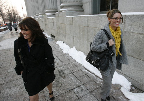 "Francisco Kjolseth  |  The Salt Lake Tribune Twin sisters Valerie, left, and Vicki Darger, both married to Polygamist Joe Darger along with third wife Alina, not pictured, leave Federal court in Salt Lake City following a hearing of arguments in the ""Sister Wives"" lawsuit challenging Utah's bigamy laws."