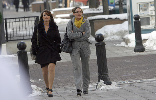 "Francisco Kjolseth  |  The Salt Lake Tribune Twin sisters Valerie, left, and Vicki Darger, both married to Polygamist Joe Darger along with third wife Alina, not pictured, get ready to enter Federal court in Salt Lake City for a hearing of arguments in the ""Sister Wives"" lawsuit challenging Utah's bigamy laws."