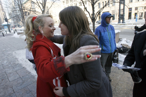 "Francisco Kjolseth  |  The Salt Lake Tribune Christine Marie, left, of Voices with Dignity and Jennifer Broadbent, a former polygamist with the Warren Jeffs group, share a hug of support as they appear outside Federal court in Salt Lake City to speak in opposition to the practices of the FLDS on Thursday, January 17, 2013. A hearing was being held in the ""Sister Wives"" lawsuit challenging Utah's bigamy laws."