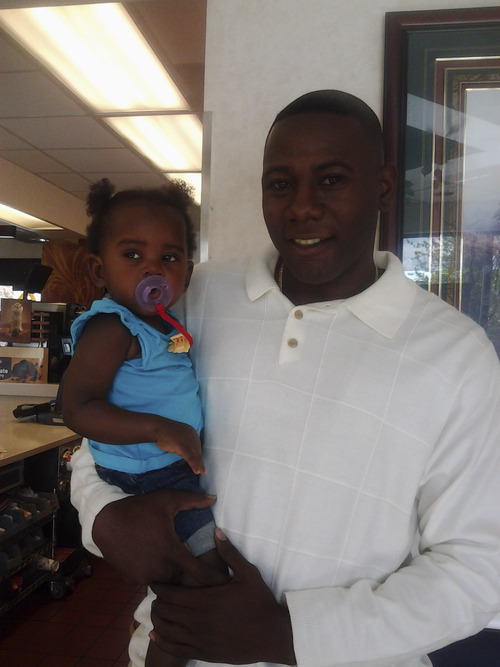 "Courtesy photo Terry Achane with his daughter, whom he named Teleah. ""There are precious moments I can't get back."""
