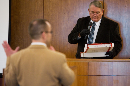 Douglas Squire, right, with the Utah County Sheriff's Office, presents evidence to prosecutor Tim Taylor during day two of the trial of Martin Bond at the Fourth Judicial District Court in American Fork Thursday, Jan. 17, 2013. Bond is accused of killing former BYU professor Kay Mortensen in November 2009.  MARK JOHNSTON/Daily Herald