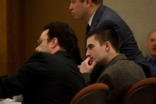 Martin Bond listens to his attorney during day two of his trial at the Fourth Judicial District Court in American Fork Thursday, Jan. 17, 2013. Bond is accused of killing former BYU professor Kay Mortensen in November 2009.  MARK JOHNSTON/Daily Herald
