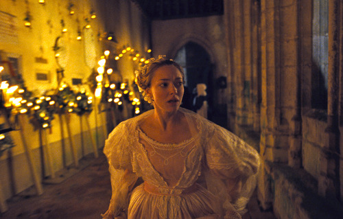 """This image released by Universal Pictures shows Amanda Seyfried as Cosette in a scene from """"Les Misérables.""""  The costumes for the film were designed by Spanish designer Paco Delgado. (AP Photo/Universal Pictures)"""