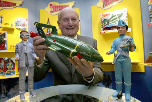"""FILE - In this Jan. 27, 2005 file photo, Gerry Anderson, poses for a photograph with a toy Thunderbird 2 on the 40th anniversary of the Thunderbirds first broadcast, in London. Anderson, the British creator of the hit """"Thunderbirds"""" TV show, died Wednesday, Dec. 26, 2012 at age 83. He is survived by his wife, son Jerry, and three other children. (AP Photo/PA, Hugo Philpot, File)"""