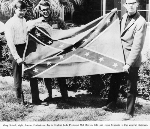 This photo from the 1969 edition of The Confederate, Dixie State College's yearbook, shows Student Body President Mel Bower receiving a gift of a Confederate flag.