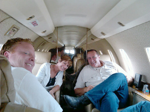 Jeremy Johnson, left, Utah Attorney General Mark Shurtleff, right, and Sandra Lucus are pictured in Johnson's jet on a trip to southern California to raise money for Lucus' Meth Cops program. Facebook Photo