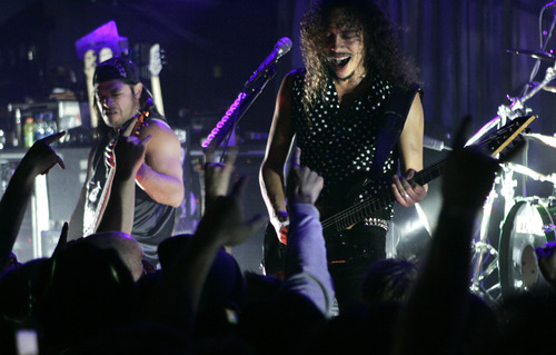 """Metallica's Kirk Hammett, right, and Robert Trujillo perform with the band during a party for the film """"The Darwin Awards"""" at the Sundance Film Festival in Park City, Utah, Wednesday, Jan. 25, 2006. Metallica appeared in the film.  (AP Photo/Carolyn Kaster)"""