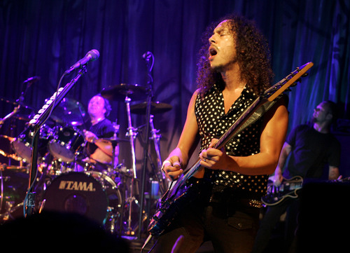 """Metallica's Kirk Hammett center, James Hetfield, right and drummer Lars Ulrich perform during at a party for the film """"The Darwin Awards"""" at the Sundance Film Festival  in Park City, Utah, Wednesday, Jan. 25, 2006. Metallica appeared in the film. .  (AP Photo/Carolyn Kaster)"""